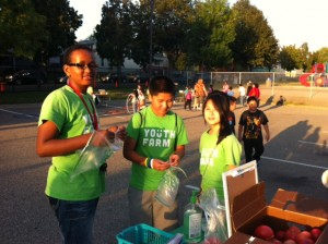 Project LEAD in Frogtown give away tomatoes at the Jackson Elementary Carnival.