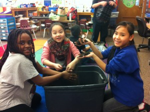 Saide, Hannah, and Wah Eh learn and play with soil.