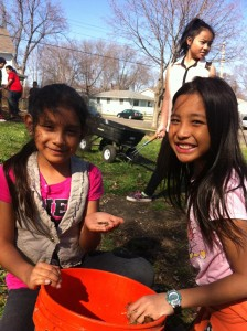 Jocelyn and Pa Saw collect worms in a bucket.