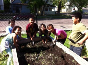 Youth Farmers plant potatoes at Jackson Elementary.