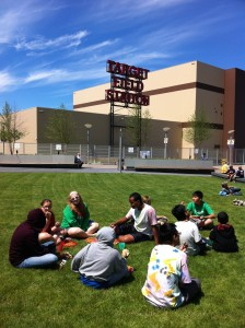 Frogtown youth eat a picnic lunch outside the stadium.
