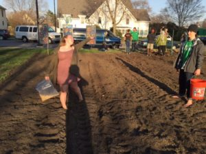 Powderhorn Project LEAD Liv with her best Earth Mother impression as she spread cover crop at the newly plowed Baha'i site