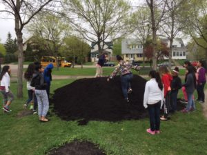 Green Central students dancing bare foot in the hot steaming compost