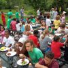 Youth, Staff, and Community members eat lunch together at our CHT farm in Lyndale/South Minneapolis.
